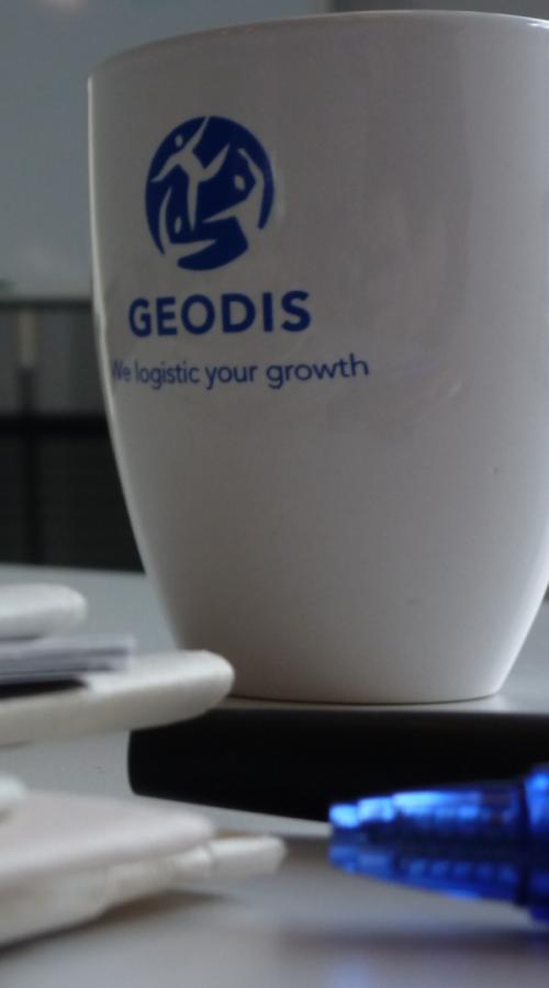 GEODIS mug and books