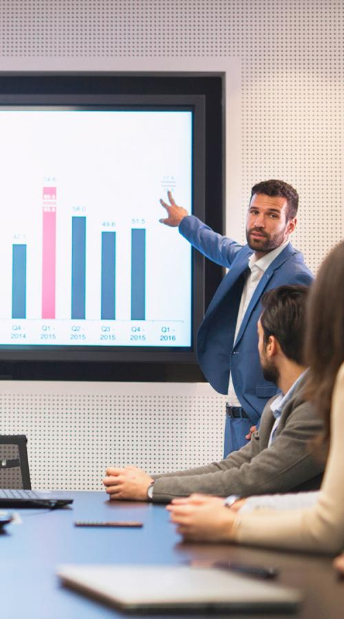 A businessman showing presentation to his colleagues