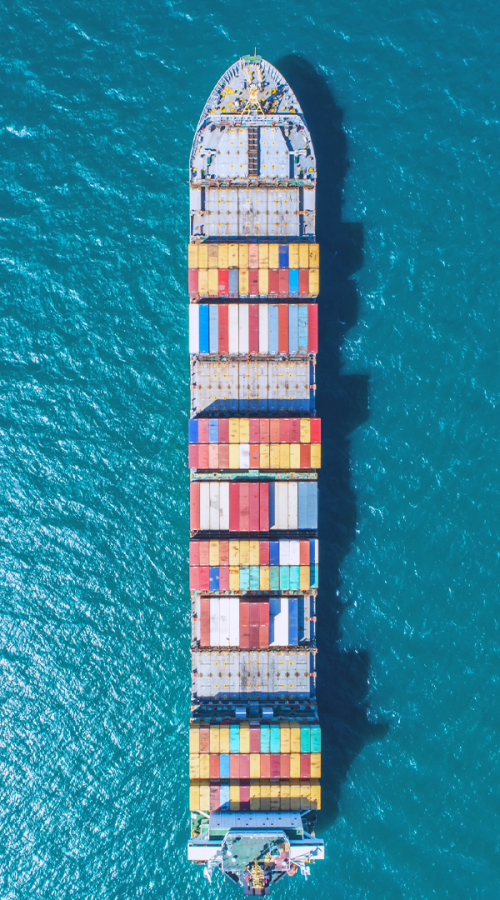 a boat carries containers on the ocean